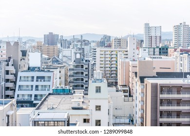 Asia Business concept for real estate and corporate construction - panoramic urban townscape aerial view with Fukuoka tower under bright blue sky and sun in tenjin, Fukuoka Japan