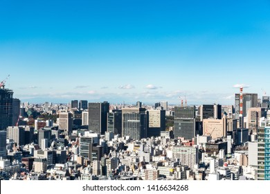 Asia business concept for real estate and corporate construction - panoramic urban city skyline aerial view under blue sky in hamamatsucho, tokyo, Japan