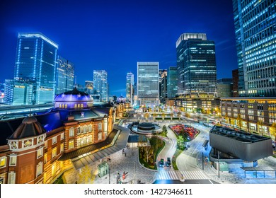 Asia Business concept for real estate and corporate construction - panoramic view of modern city skyline and tokyo station night view in tokyo, japan