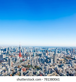 Asia Business concept for real estate and corporate construction - panoramic modern city skyline bird eye aerial view of tokyo tower under bright sun and vivid blue sky in Roppongi Hill, Tokyo, Japan