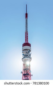 Asia Business concept for real estate and corporate construction - close up view of Tokyo Tower with bright blue sky