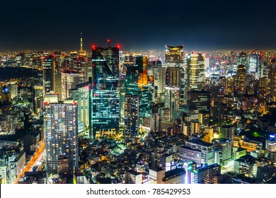 Asia Business concept for real estate & corporate construction - panoramic modern city skyline view of Tokyo Metropolitan Expressway junction with neon night in Roppongi Hill, Tokyo, Japan