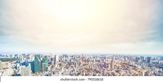 Asia Business concept for real estate and corporate construction - panoramic modern city skyline bird eye aerial view odaiba under golden sun in Roppongi Hill, Tokyo, Japan