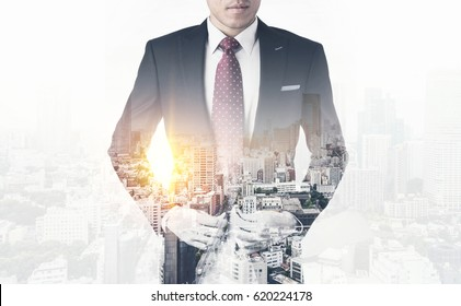 Asia business concept - thoughtful modern office man  with dark suit, stand and think the business plan. Double exposure effect with Japan city skyline background