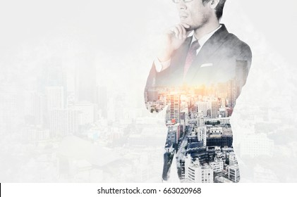 Asia business concept - thoughtful modern office man with dark suit, stand and think the business plan. Double exposure effect with Japan city skyline background. Mix hand drawn sketch illustration