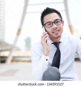 Asia business man using a mobile phone with copyspace