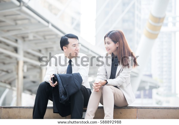 Asia business people or businessman and businesswoman working outdoor, Protrait business concept.