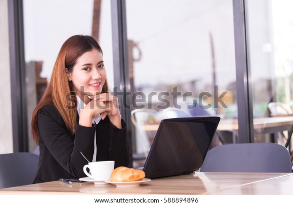 Asia business people or businesswoman take a break with coffee cup, Protrait business concept.