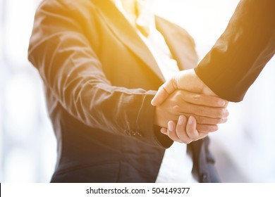 Asia business people handshaking.