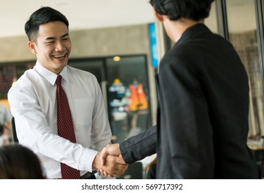 Asia businessman handshake with Partner, Business teamwork concept.