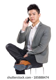 Asia businessman sitting on chair and talking to mobile