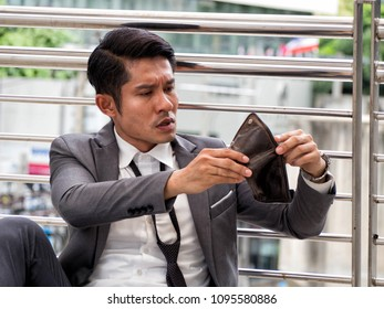 Asia Businessman with stress situation for money, Businessman have no money unemployed and Bankrupt concept,