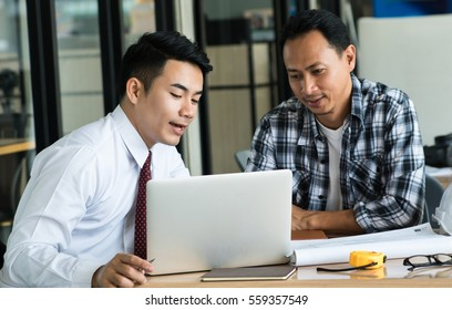 Asia businessman talking and presentation with engineer or co-worker.