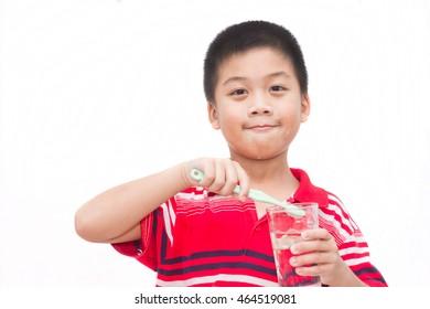 Asia child brush teeth care oral health.