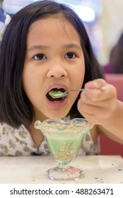 Asia child Eating Ice-Cream. Children eating candy.