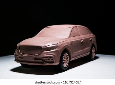 Asia, China, Chongqing - October 25, 2017: A clay car model made by a car designer is displayed in the black exhibition room for the media to watch