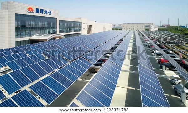 Asia, China, Jiangsu, May 23, 2018: Photographer Xie Yiliang aerial photography of solar panels in the roof of Jiangsu Zhongli Tenghui headquarters in sunny weather