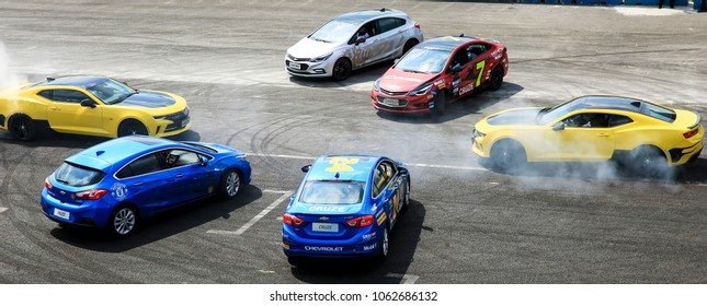 Asia China Shanghai - July 11, 201: Motorcycle lovers and car lovers play stunts on the road
