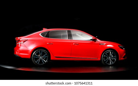 Asia China Shanghai - October 12, 2017: A new car unlisted red MG 6 sedan shows its side in a black background