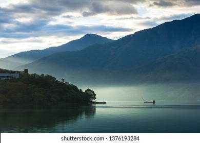Asia culture - Beautiful landscape of lake level reflect fantasy dramatic sunrise sky in Sun Moon Lake , in Taiwan, Asia. the famous travel attractions in Nantou ,Taiwan. Scenery of Sun Moon Lake,