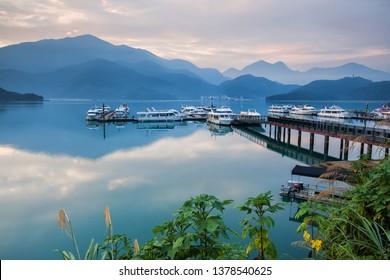Asia culture - Beautiful landscape of lake level reflect fantasy dramatic sunrise sky in Sun Moon Lake , in Taiwan, Asia. the famous travel attractions in Nantou ,Taiwan. Scenery of Sun Moon Lake