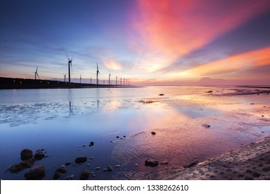 Asia culture - Beautiful landscape of sea level reflect fantasy dramatic sunset sky  in Gaomei wetlands , the famous travel attractions in Taichung, Taiwan.