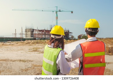 Asia engineer construction standing see plan paper