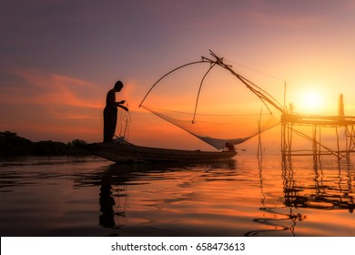 Asia Fisherman on the fishing boat at the lake, Asian lifestyle living in the countryside.