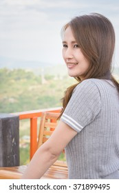 asia girl relax at outdoor balcony on natural mountain