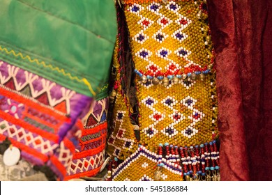 Asia, India, Rajasthan,Udaipur. brightly colored materials, embroideries and beaded items in the markets.