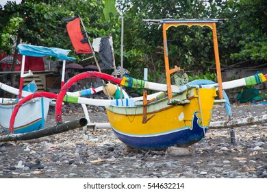 Asia, Indonesia, Bali. fishing boat along the Bali coast, resting on shore.