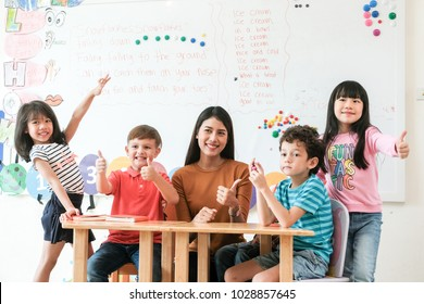 Asia kids and teacher learning english in classroom at school, Asian english teacher and diverse children classroom, Diverse kids at  pre school class, Kindergarten, Education concept