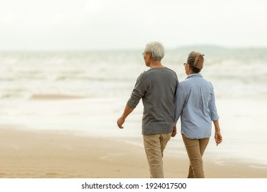 Asia Lifestyle senior couple walking chill on the beach happy in love romantic and relax time. People tourism elderly family travel leisure and activity after retirement in vacations and summer.