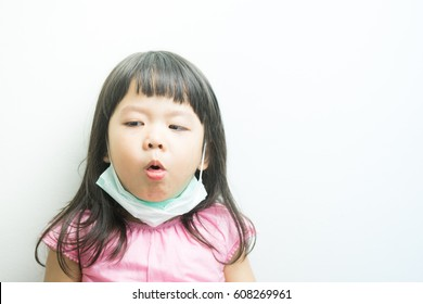 Asia little girl cough.Virus protection concept.