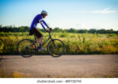 Asia man ride bike for exercise,  blurred image for background