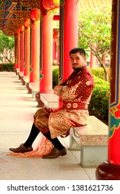 Asia man wearing typical Thai dress with Chinese Temple background identity culture at Bangkok of Thailand