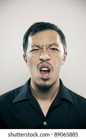 asia men make a exaggerated facial expression