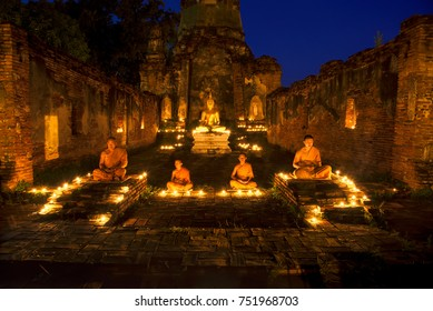 Asia monk vipassana for meditation at old temple of Thailand.