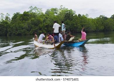 asia people in the boat, Sri Lanka, Koggala lake, 16 June 2014