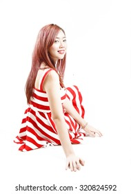 asia pretty girl in red white dress sit on floor. in studio white background