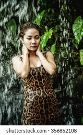 asia sexy girl under a relaxing hot spring waterfall