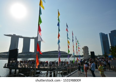 Asia / Singapore - January 26, 2019 : Singapore famous travel tourists attractions. Merlion statue symbol, Marina Bay Sands Hotel Casino.