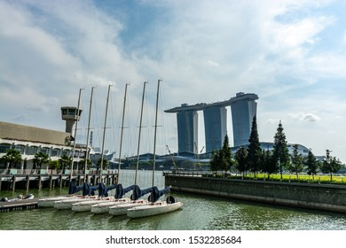 Asia / Singapore - January 26, 2019 : Landscape of Singapore Financial Central Business District. Marina Bay Sands Hotel Casino in background. Reflection water fountain.