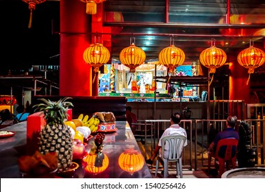 Asia / Singapore - July 17th 2019 : Chinese Teochew Opera. Audience enjoying traditional opera performance. Seventh Month Ghost Festival.