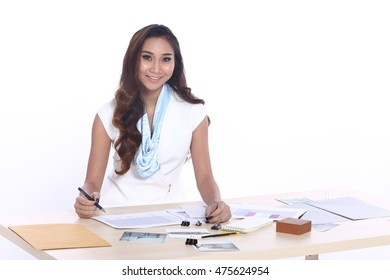 Asia Tan Skin Girl, Business Working Woman Model in White Dress executive look, Modern Wooden Desk with stuff, file and paper, copy space for text logo