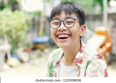 Asia teenager with teeth brace dental smiling and happy for lifestyle or healthcare concept background in Vintage tone.