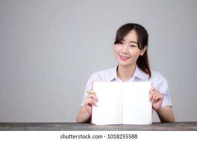 asia thai high school student uniform beautiful girl read a book