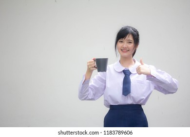 asia thai high school student uniform beautiful girl drinking hot drink