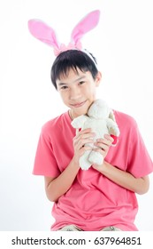 Asia transvestite holding rabbit doll isolated on white background