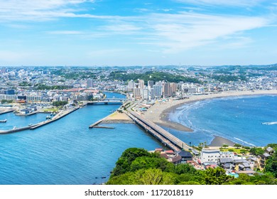 Asia travel concept -  the famous travel place, enoshima island and urban skyline aerial panoramic view under dramatic blue sky and beautiful ocean in kamakura, Japan.
